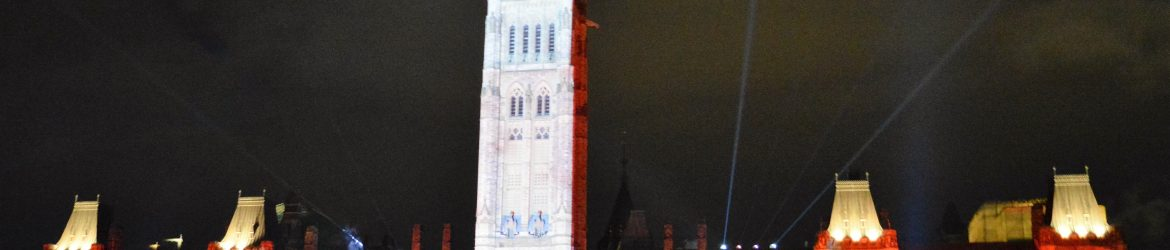 This photo represents where I come from. This is the Parliament Building in Ottawa, Canada. It was part of the Light Show they put on in the summer. I was there to obtain my first Student Visa for Finland. (Photo Credit: Danielle Gadsby)