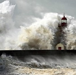 Light house in waves